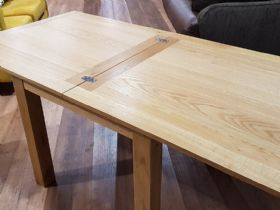 Oak square dining table extended - hinges exposed