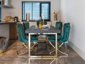 Savoy gold dining table and Fitzrovia dining chair