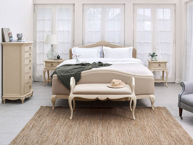 Ivory distressed bedroom furniture with rub off on edges and detail
