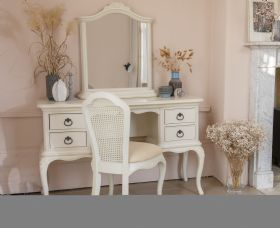 Ivory distressed bedroom furniture including rattan pieces