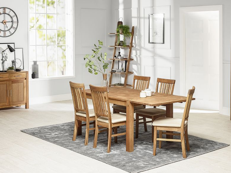 Duke dining table with additional leaf and fabric chairs