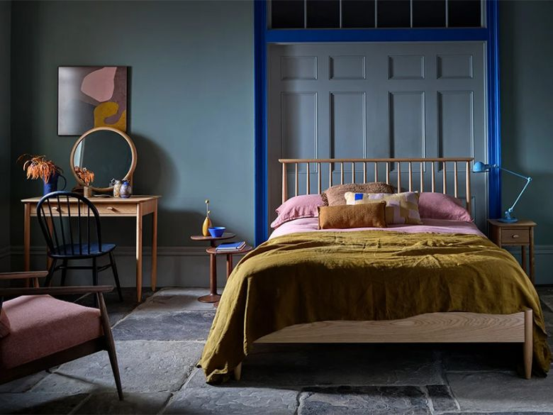 Ercol Teramo retro oak bedroom range. Features tapered legs and spindle back bedframe
